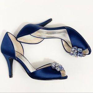 Caparros peep toe heels